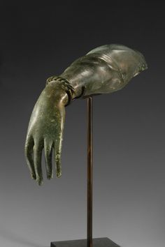Roman bronze life-size left forearm of a woman.  Wearing a twisted movable bracelet, dressed with a pleated veil on the upper part of the arm.  Ca. 3rd Century AD