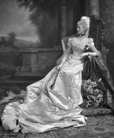 Mrs Joseph Thomas Firbank nee Harriette Garrett, later Lady Firbank, in a court dress, 1899.