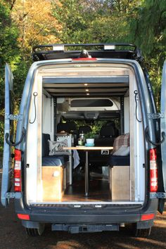 """""""The Family Van"""", a Sprinter 144 built for a family of five has an electronic bunk bed, a kitchen galley, and seating for the whole family. Van Conversion Campervan, Ford Transit Conversion, Van Conversion Interior, Sprinter Van Conversion, Conversion Van, Converted Vans, Transit Camper, Campervan Interior, Campervan Ideas"""