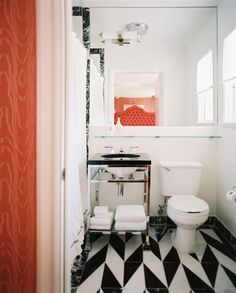 Hollywood Regency Modern Bathroom: Black-and-white patterned floors in a bathroom.