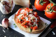 The Traditional Favourite Tomato and Garlic Bruschetta served on sourdough bread. Grating the Garlic off the crust punchy and scattering of shaved parmesan cheese this is the quintessence of Italian food room temperature tomatoes.   We mixed Tobasco and balsamic vinegar and cracke black pepper and quality olive oil. #bruschetta #sandwich #tobasco #tomatorecipe #food #foodfeels #Garlic #Brunch #supper Sourdough Bread, Balsamic Vinegar, Bruschetta, Parmesan, Italian Recipes, Tomatoes, Olive Oil, Garlic, Sandwiches