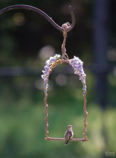 Lean how to make a hummingbird swing with just a few supplies that will have those little small birds coming back to visit more.