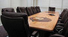 Solid red oak conference room table with wood inlaid world globe logos, one of two conference tables handmade for this Bank facility.  509-466-4684
