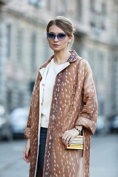 The European Guide To Flawless Style #refinery29  http://www.refinery29.com/milan-fashion-week#slide64  A classic trench coat in a brazen print (but still in a neutral color!) is so much more interesting but still matches everything.