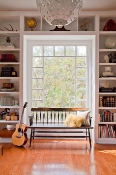Built-in bookcases surrounding large window with bench set in, could have window seat Bookshelves Built In, Built Ins, Book Shelves, Bookcases, Apartment Bookshelves, Window Shelves, Window Wall, Shelf Over Window, Playroom Shelves