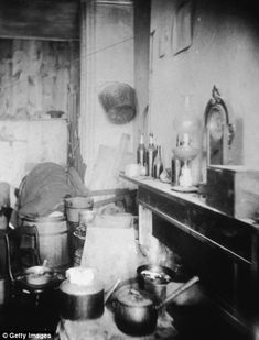An interior view of the tenement flat of an Italian family in New York City.