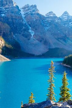 Alberta, Canada  In Banff National Park, cobalt Lake Louise glistens beneath the snowcapped Rocky Mountains.