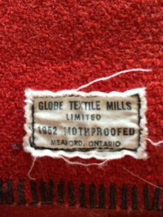 Vintage label on a Canadian Navy ship blanket, by Globe Textile Mills Limited, Meaford, Ontario.  The only label I've ever seen with a date:  1952!  My collection.