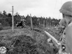 During early fighting in the Hürtgen Forest in November 1944, a frightened German soldier has decided that captivity is preferable to further resistance and quickly surrenders to troops of the U.S. 9th Infantry Division.