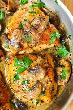 baked chicken thighs with creamy mushroom sauce and herbs