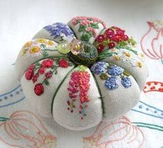 Embroidered pincushion.