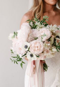 pale pinks and creams bouquet with streamer ribbons, via joy proctor design