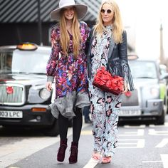 Katie Readman and @alicepalace at #LFW wearing the Matthew Williamson SS15 and PF15 collections. Katie (left) wears the Jardin Chiffon Shirt Dress and Alice (right) wears the Climbing Hibiscus Silk Shirt and Trousers with matching bag. Photo by Michaela Tornaritis #ohMW