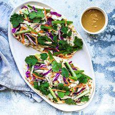 New recipe Chicken Satay Salad Flatbreads. PSA: The satay dressing is as close to eating peanut butter for dinner as you can get. Yup. That good  For the easy 15 minute recipe click the link in my bio or head over to https://ift.tt/2k4e8GZ  And in other news. Congratulations @siany_quitssugar  You are the winner of this months YTGT tote bag. For your chance to enter cook one of my recipes in April and post a pic to Instagram with  #youtotallygotthis (just make sure your account is public so…