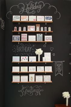 Black background makes handmade cards pop. Love using the wall as signage - chalkboard paint | craft show display