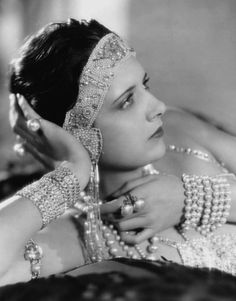 Jewellery in the 1920's was very elaborate and was laid on heavily. Earlier on, the jewellery was composed of mainly thick pearl beads. However, after the dicovery of King Tutankhamen's tomb, Egyptian styled jewellery became very popular. This photograph displays the expensive and beautiful jewellery worn by girls of all ages, especially flappers