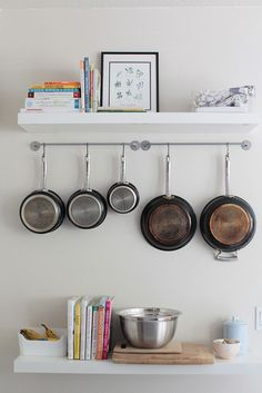 If you're tight on space in the kitchen, wall hooks or hangers are a great way to store pots, pans, cookbooks, and kitchen tools.