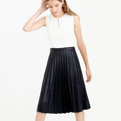 ✨HP✨🆕 NWT J. Crew Faux Leather Pleated Dress 🌟Essential Style HP🌟 NWT Really elegant with a bit of an edge, the perfect skirt and top combo turned into a dress.   Drapey, ivory sleeveless top, finished with a pretty keyhole  that falls to a full, black faux leather pleated skirt. Zips in back.  STUNNING! I so wish you could see this in person; the photos do not do it justice! J. Crew Dresses