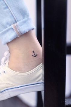 Tiny anchor tattoo on the right inner ankle. Tattoo artist: Mini...