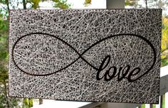 Perfect for Valentines!!  Elegant love, showcased by golden nails, dark wood, and off-white string. Beautiful, and infinite love!  Measures 26x16