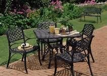 cast iron patio furniture helps make this yard all the more inviting bing images