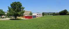 The further development and change of the primary and secondary school in Neunburg vorm Wald, a town in the Upper Palatinate, a part of Bavaria, Germany made it necessary to extend the campus with … Mensa, Secondary School, Golf Courses, Mansions, House Styles, Fire Safety, Regensburg, Wicker, Woodland Forest