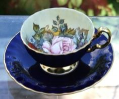 Navy blue exterior with pink rose interiior Teacup by nora