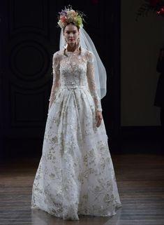 Naeem Khan Fall 2016 long sleeve a-line wedding dress with embellished floral appliqués | https://www.theknot.com/content/naeem-khan-wedding-dresses-bridal-fashion-week-fall-2016