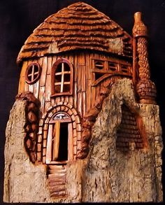 In the Round Cottonwood Bark Gnome House (front) with opening door and spiral brick chimney. Carved by N. Minske.