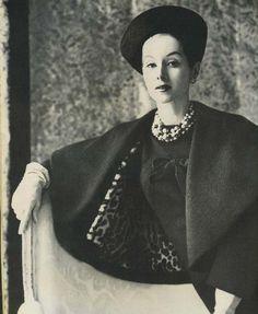 A 1959 Pauline Trigere suit, includes spiralled S-curve jacket & narrow wool dress, lined in leopard-print Italian lambskin.