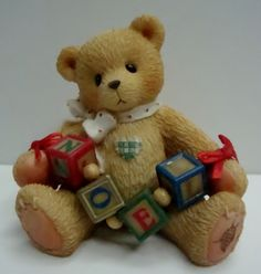 """Enesco Cherished Teddies """"Noel"""" Bear Figurine. It comes with the original box. This adorable bear figurine is about 3"""" tall and in good condition. However, one of the tiny, round felt pads is missing from the bottom (see pictures), and there is some stickiness in that area, possibly from an old price tag. The box is in decent condition, though there is some damage (part of the top surface of the cardboard has been torn off. Shipping is free within the United States. Due to the cost of ..."""