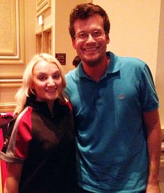 This appears to be Evanna Lynch in a Hunger Games shirt with John Green.