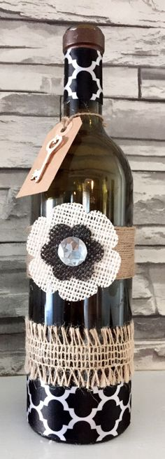Recycled rustic decorative dark green Wine Bottle embellished with burlap and linen flowers. Perfect centerpiece for your house and office. Measurements 11.5 in Tall x 10 in diameter.