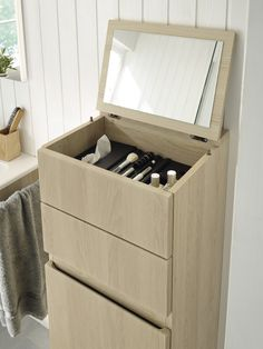 Surprisingly ingenious, this cosmetics storage unit. Not only does it present all of the respective accessories like a silent personal valet, it also holds the mirror for you.