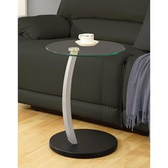 Decorate your home in style with this attractive silver tempered-glass accent table. This sleek table adds class to your interior design with its curved silver support leg, black circular wood base, and circular tempered glass table top.
