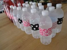 baby shower or any party idea ! Cute and would eliminate need for water glasses Idea --- bottled water in cooler, use design duct tape to cover labels and fit theme colors. Cute! Could easily get at the dollar store!