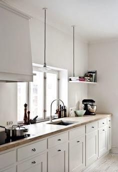 timber benchtop, pendant lights.