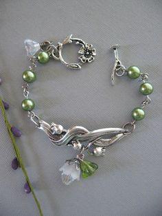 Lily of the Valley Bracelet, Lily Bracelet, Silver Bracelet, FlowerBracelet, Bridesmaid, Flower Girl, Green Pearls. $22.50, via Etsy.