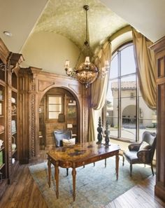 Impressive groin vault ceiling, huge arched window overlooking a courtyard fountain, and exquisite woodwork... now if that arched opening leads to a separate work space where the real clutter of an office could hide, this Study would be perfect.