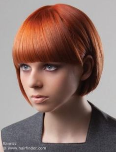 Red hair cut into a short bob with bangs
