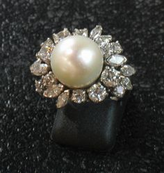 Spendid platinium ring with a beautiful cultured pearl surrounded by round  and strip shape diamonds. So stylish !20th Century. For sale on Proantic by Blanc-Anselme.    #diamond    #pearl