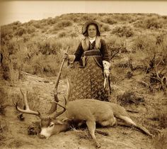 """Augusta """"Gusty"""" Wallihan, a noted huntress of the era, with one of her trophy mule deer and her Remington-Hepburn rifle in 1895."""