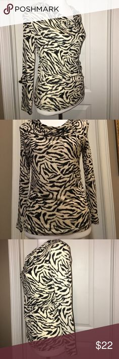 MICHAEL KORS Zebra Print Top NWOT Beautiful lightweight long sleeve Michael Kors Zebra print top. P/M. Please see other listings in my closet!  I only list new or EUC pieces that are clean and snag, stain and flaw-free (unless otherwise stated).  Only items that I'd be happy to own myself!  Any questions, just ask!  I do bundle and while I've priced to sell, will consider any reasonable offers!  🛍 Happy Poshing! Michael Kors Tops Tees - Long Sleeve