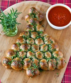 Perfect for holiday parties, this pull-apart Christmas tree bread is dipped in marinara sauce. Kids will love it, too!