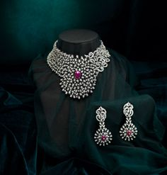 oh wow...diamonds and rubies!! wish my parents had got me this for my wedding! lol