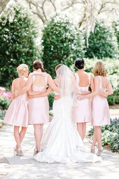 These Alfred Sung bridesmaids look as chic in the back as they did in the front. Maybe even a touch more! We love the pink bow in the back for the dress.