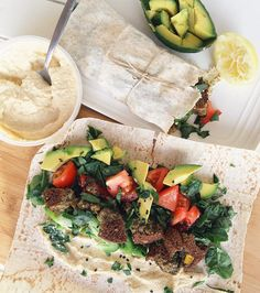 Falafel wraps loaded with hummus, spinach, tomato, capsicum, avocado, sesame & lemon juice