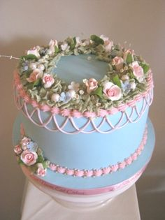 Old fashioned flowery celebration cake, from Let Them Eat Cakes.