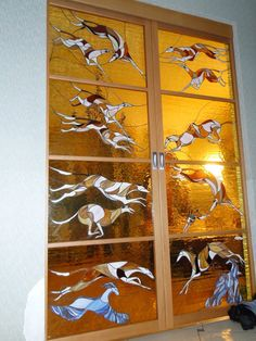 Beautiful greyhound stained glass panels