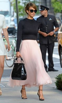 For style inspiration purposes, it's this great outfit by Jessica Alba, though. Brighten up your winter wardrobe by teaming long floaty dresses with tailored jumpers and strappy heels, and keep a warm scarf in a big bag. Don't be afraid to mix your colours, either – black and pastel pink here look great!